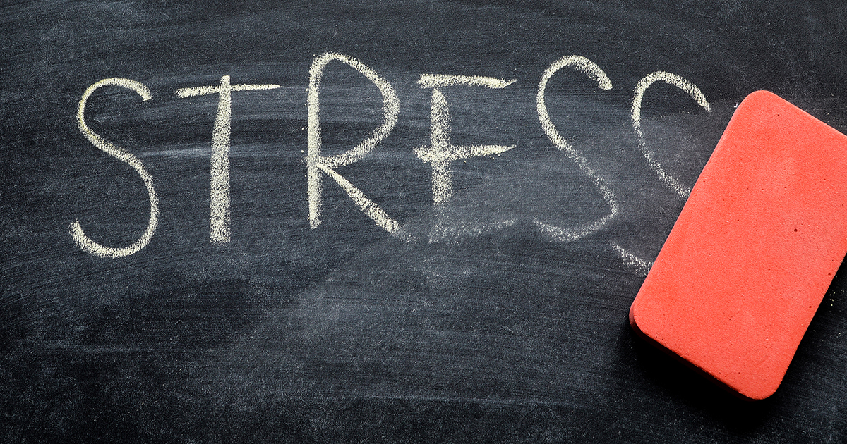 The word stress is written on a chalkboard, partially wiped off with an eraser.