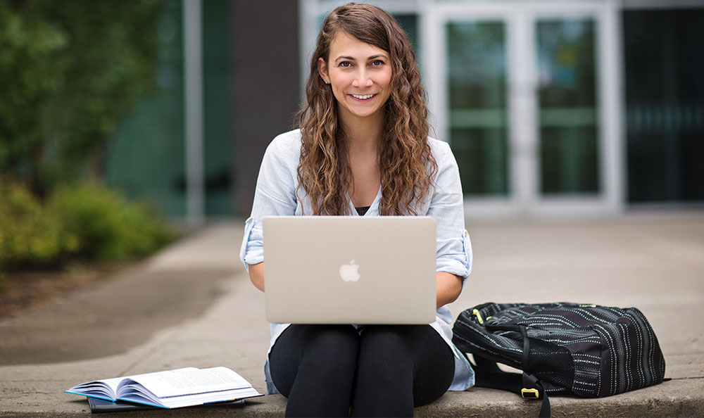 Business student with a laptop
